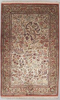 A RUG, Old silk Qum, around 212 x 135 cm.