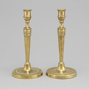 LJUSSTAKAR, ett par, empire, brons, 1800-talets första hälft.