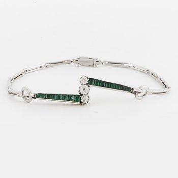 An 18K white gold, diamond and emerald bracelet.
