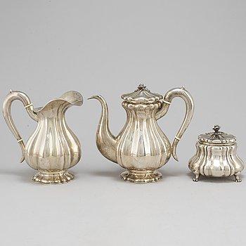 A SILVER COFFEE POT, CREAMER AND SUGAR BOWL. Austria-Hungary. 1872-1922.