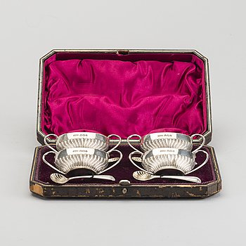 An English set of four silver salters with spoons mark of James Dixon & sons Sheffield 1895, weight 166 gr.