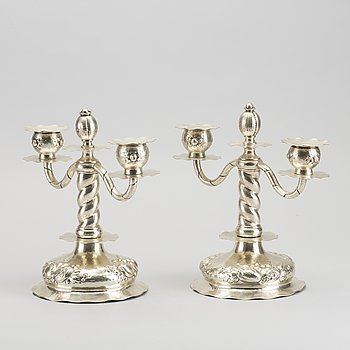 A pair of Swedish 20th century silver candelabras mark of CG Hallberg Stockholm 1941.