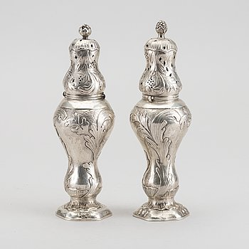 A pair of Rococo style silver suger despencers, later part of the 19th century, weight ca 415 gr.