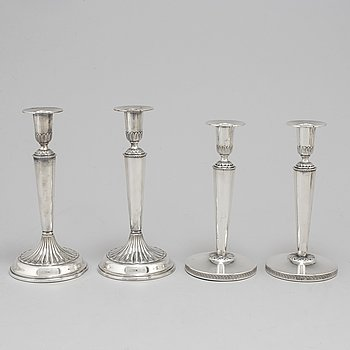 Two pairs of Swedish silver candlesticks, 1987 and 1971-72.