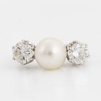 A brilliant-cut diamond and pearl ring.