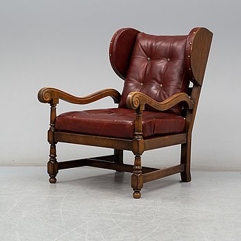 A late 20th Century baroque style easy chair.