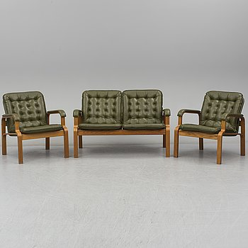 A sofa with two easy chairs, late 20th Century.