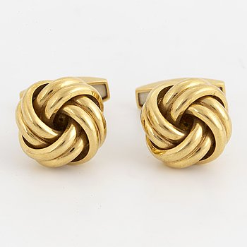 18K gold knot-shaped cufflinks.