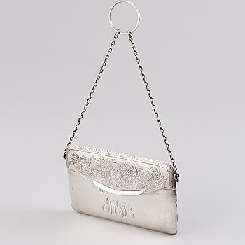 A sterling silver card holder, mark of William Hair Haseler, Birmingham 1911.