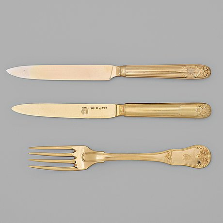 An early 19th century silver-gilt 24 piece table cutlery, mark of p zethelius and g folcker, sthlm 1806 and 1826.