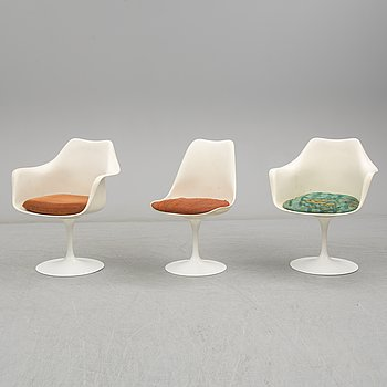 Two 'Tulip' armchairs and a chair by Eero Saarinen, Knoll International.