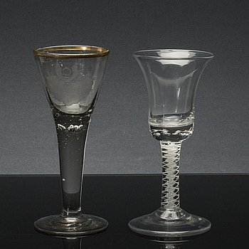A set of two 18th century wine glasses.