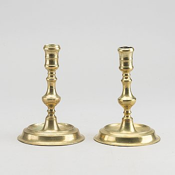 A set of two of brass candle sticks mid 18th century.