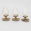 A set of  three early 20th century cut glass lamps.