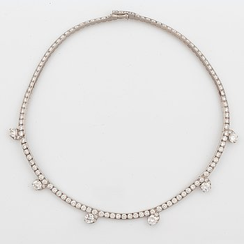 1013. A Cartier necklace in platinum and 18K gold set with round brilliant-cut diamonds.