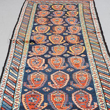 A semi-antique west persian runner, around 350 x 114 cm.