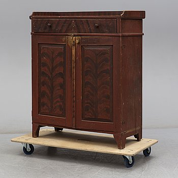 A first half of the 19th century cupboard.