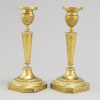 A pair of 1830s/1840s late Empire brass candle sticks, probably Russia.