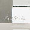 Oiva toikka, an annual glass cube, signed oiva toikka nuutajärvi 1985, numbered 527/2000.