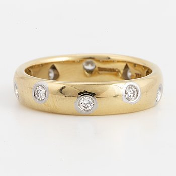 A Tiffany & Co 18K gold and platinum and brilliant-cut diamond ring.