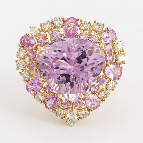 A kunzite, pink sapphire and diamond cock tail ring.