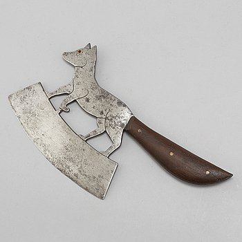 A 19th century iron meat cleaver.