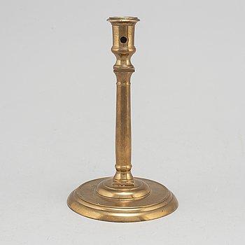 An 16th century bronze candlestick.