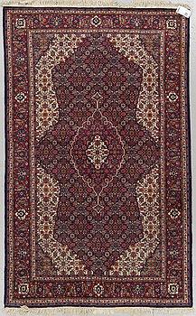 An oriental rug, around 204 x 125 cm.