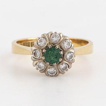 18K gold emerald and brilliant-cut diamond cluster ring.