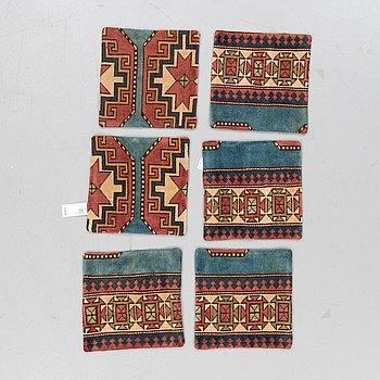 Six carpet cushions, around 40 x 40 cm.