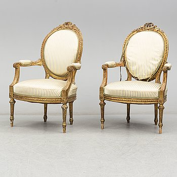 A pair of French Louis XVI-style armchairs, late 19th century.
