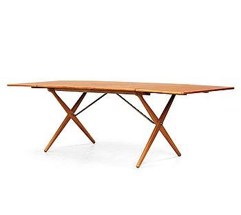 353. Hans J Wegner, a teak and oak drop-leaf dining table, Andreas Tuck, Denmark 1950'-60's.