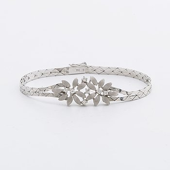 ARMBAND 18K vitguld m briljanter ca 0,25 ct totalt.
