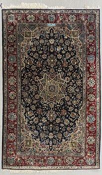 A semiantique signed silk carpet ca 213 x 137 cm.
