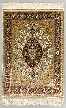 An old Hereke silk part relief signed carpet ca 132 x 102 cm.