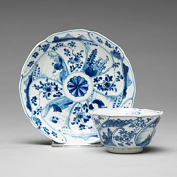 A set of three blue and white cups with stands, Qing dynasty, Kangxi (1662-1722).