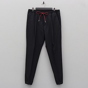 CHRISTIAN DIOR,  a pair of black virgin wool trousers, French size 52. 2017.