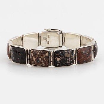 A sterlingsilver and porphyry bracelet.