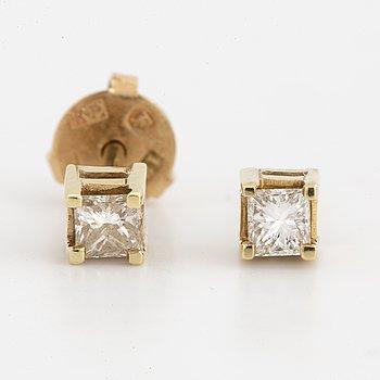 18K gold princess-cut diamond stud earrings.
