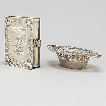 A silver bowl and book cover, 19th century.