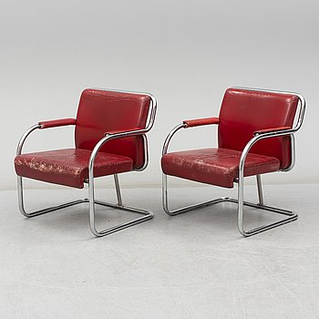 A pair of 1920s armchairs.