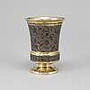 A russian mid 19th century silver-gilt and niello beaker, unidentified makers mark, moscow 1845.