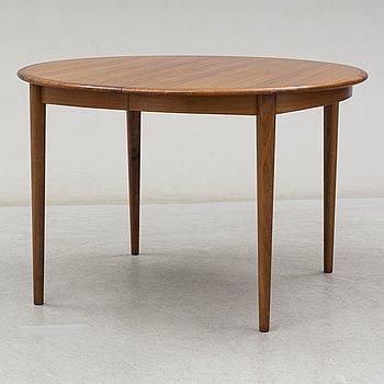 A 1960s mahogany dining table.