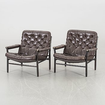 A PAIR OF EASY CHAIRS BY DUX.