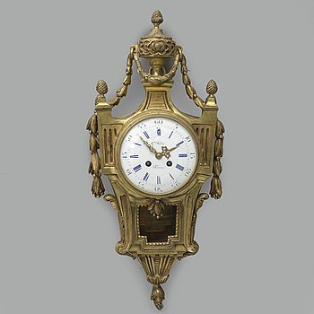A 19th century Louis XVI style wall clock, signed G. Fabre a Paris.