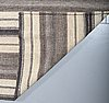 A flatweave rug, 338 x 254 cm