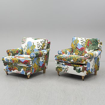 A pair of modern armchairs.