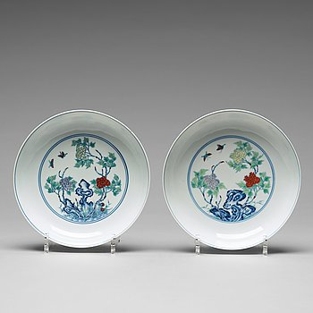 606. A pair of 'butterfly and peonies' dishes, Qing dynasty with Yongzheng mark.