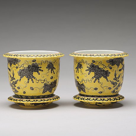 A pair of yellow glazed dayazhai mark flower pots with stands, republic, 20th century.