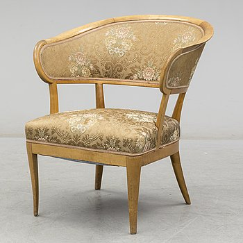 A second haf of the 20th Century 'Love' birch armchair by Carl Malmsten.